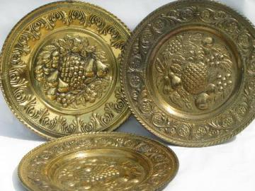 embossed solid brass chargers, large plates or trays, fruit patterns