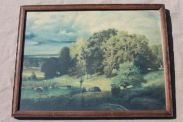 faded vintage print, pastoral landscape scene cows on pasture in shabby wood picture frame