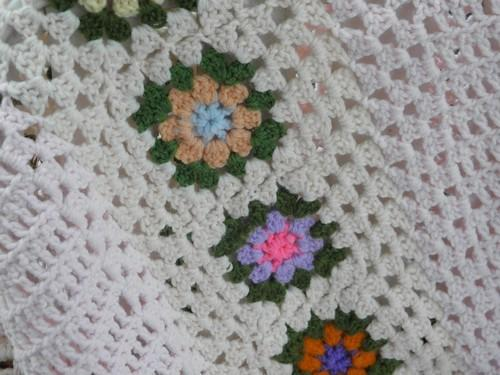flower garden granny squares on pale pink, vintage crocheted afghan