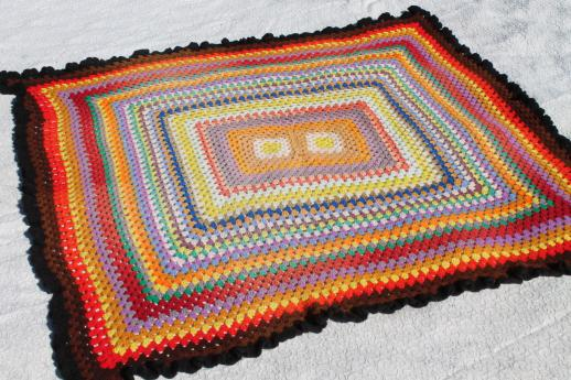 giant crochet granny square afghan in a rainbow of retro colored scrap yarn