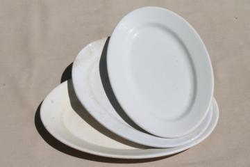 graduated sizes stack of old antique vintage white ironstone china platters