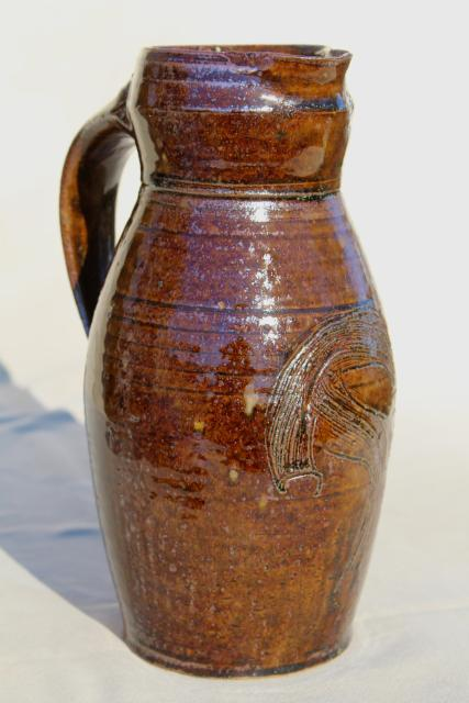 hand thrown pottery milk pitcher or rustic vase, brown glazed heavy stoneware, artist signed