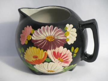 hand-painted flowers on black, vintage Ransburg stoneware pottery pitcher