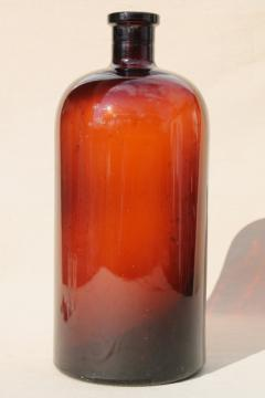 huge old apothecary bottle, pharmacy chemical bottle in root beer brown amber glass