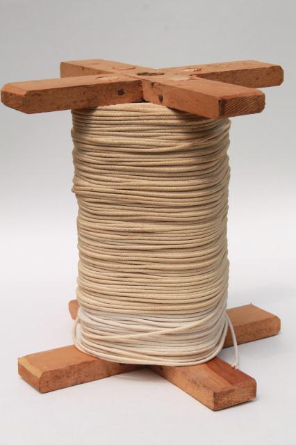 huge spool of grubby old cotton cord light rope texture string for