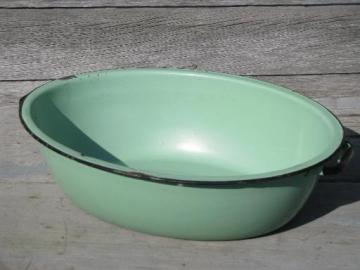 jadite green vintage enamelware, big old primitive wash tub, oval dish pan
