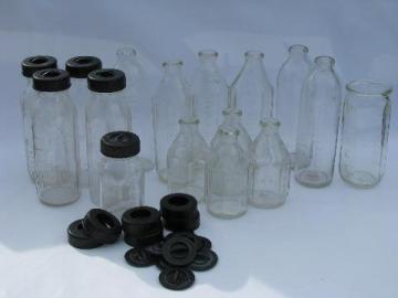 large lot assorted old glass baby bottles, vintage bakelite lids