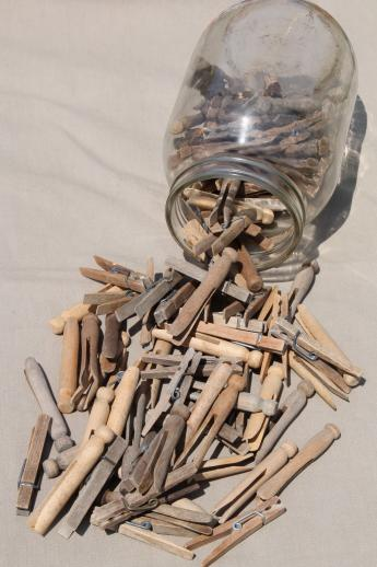 large old gallon jar full of vintage clothespins, primitive wood clothespins lot