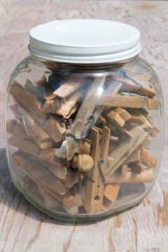 large old glass jar full of vintage clothespins, primitive wood clothespins lot