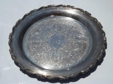 large round vintage Oneida tray, silver plate over heavy copper or brass