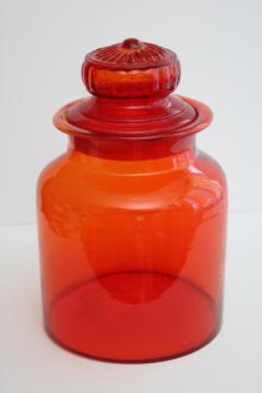 large vintage glass canister or apothecary jar, tangerine orange glass bottle w/ lid