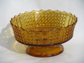 large vintage pressed glass footed bowl, jewel & band pattern in amber