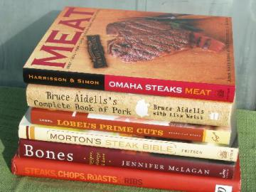 lot big specialty cookbooks, steaks, chops, roasts, bones - all meat!