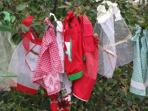 lot of 8 vintage red and green holiday aprons, Christmas prints etc.