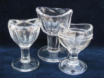 lot of antique & vintage pressed glass eye wash cups, all different patterns