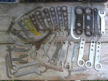 lot of assorted old and vintage stamped wrenches, steampunk hardware