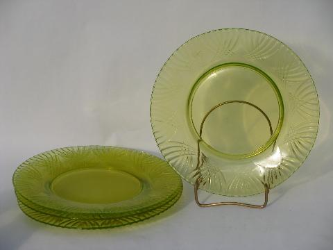 lot of four vintage yellow-green vaseline pressed pattern glass plates