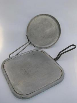 lot of vintage aluminum griddles for chuck wagon or campfire cooking