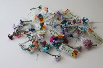 lot of vintage flower picks, tiny ribbon roses on florists wire, craft flowers