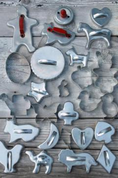 lot of vintage metal cookie cutters, old aluminum cookie cutters w/ red handles etc.