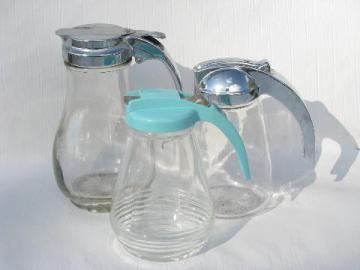 lot of vintage syrup pitchers, glass jars, chrome or aqua plastic lids
