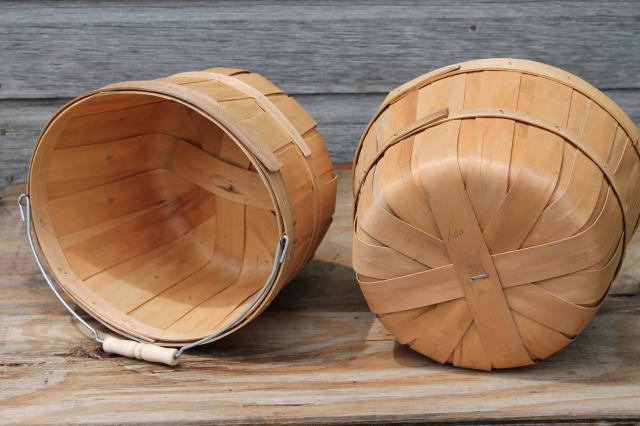 lot old farmer's market wood baskets for orchard or farm garden stand produce, shop displays