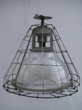 mid-century industrial machine-age vintage Holophane ceiling light with glass shade and wire cage