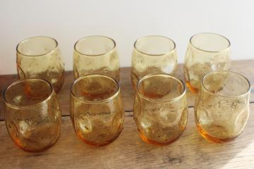 mid-century mod vintage textured amber glass roly poly glasses, pinch shape thumbprint tumblers