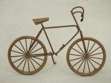 miniature brass bicycle with working wheels, machine age steampunk style!