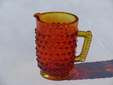 miniature glass pitcher, vintage hobnail pattern glass, amberina orange