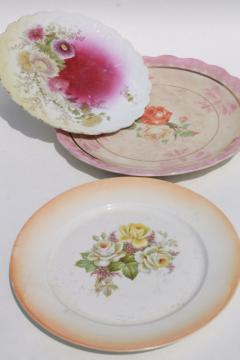 mismatched vintage china, antique plates w/ shabby roses & floral bouquets