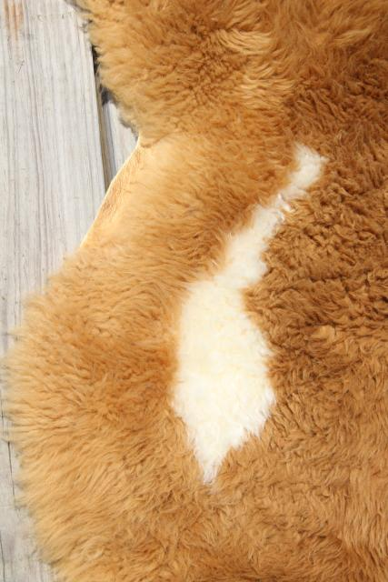 natural wool sheepskin fur rug or seat cover, brown & white hide w/ soft fuzzy pile