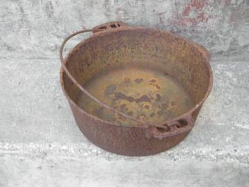 old antique cast iron dutch oven pot for wood stove/campfire cooking