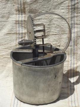 old antique egg beater, tinned steel bowl and hand-crank whipper beaters