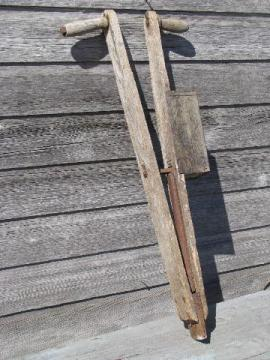 old antique farm tool, hand corn seeder, primitive garden planter
