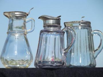 old antique glass syrup jugs lot, lidded pitchers 1914 and 1915 vintage