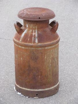 old antique primitive milk can for yard, nice patina