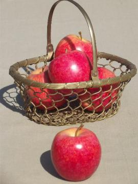 old brass basket full of autumn apples, rustic fruit centerpiece for fall
