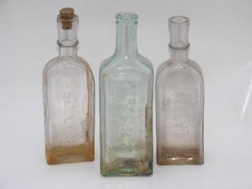 old embossed glass Seely's and Ayer's Sarsaparilla tonic medicine bottles
