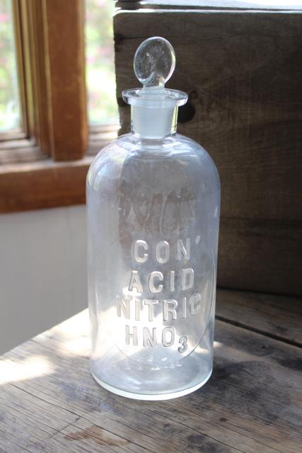 old embossed glass bottles, antique apothecary pharmacy chemical bottle vintage lab glass