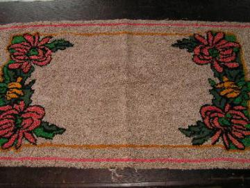 old flowered hooked rug, wool yarn