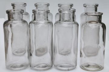 old glass apothecary bottles, vintage clear glass jars, tall canister bottle lot