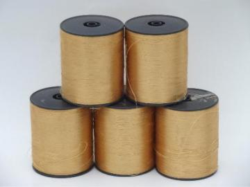 old gold silk or rayon floss, silky satin embroidery or wrapping thread