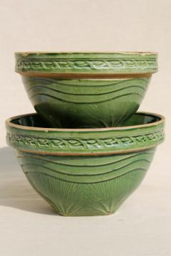 old green glaze yellow ware pottery mixing bowls, pine branch pattern stoneware bowl nest