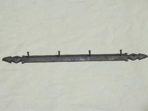 old hanging rack for kitchen utensils, wall mount cast iron peg board
