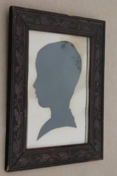 old paper silhouette picture in antique oak leaf and acorn carved wood frame