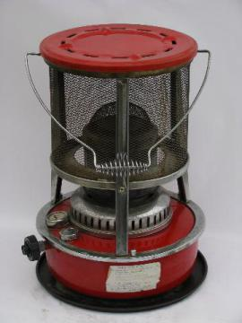 old red enamel kerosene camp heater, vintage camping gear