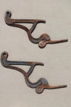 old rusty  iron hardware ladder hooks,  vintage farm primitive tool