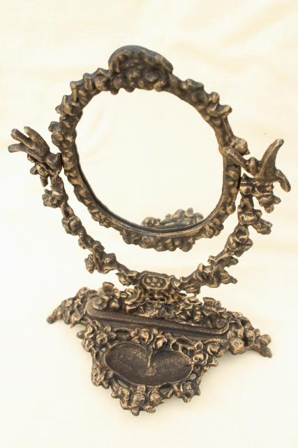 ornate old cast iron tilt mirror on stand, shaving or vanity table mirror