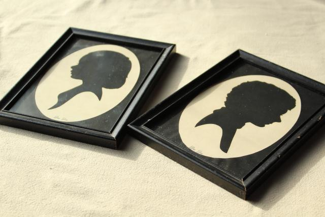 pair framed vintage silhouette paper cuts, 1940s boy & girl portraits